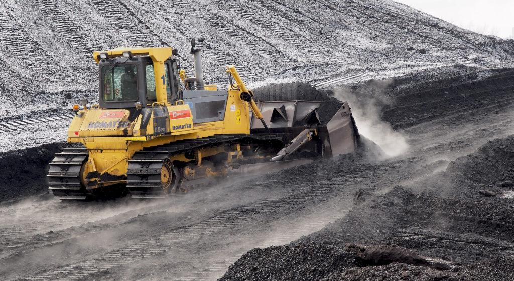 Komatsu D85 pushing Indonesian coal in Power plant